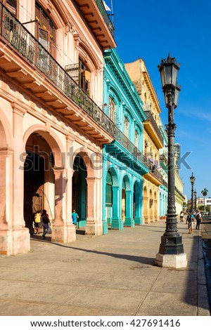 Street scene with colorful buildings in downtown Havana right in front of the Capitol - stock photo