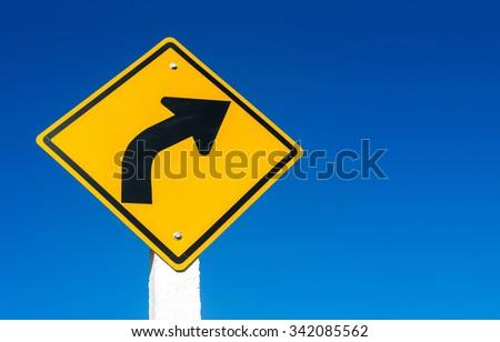 street sign against blue sky - stock photo