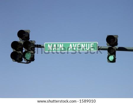 "Street sign and ""go"" traffic signal, Main street, USA - stock photo"