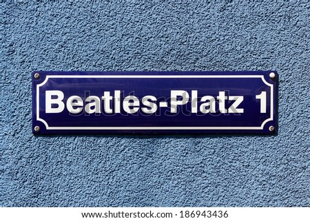 Street sign of Beatles Square at the corner of Reeperbahn and Gross Freiheit, in the middle of the infamous red light district of Hamburg, Germany. - stock photo