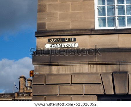 street sign on building side Royal Mile Lawnmarket Edinburgh Scotland United Kingdom