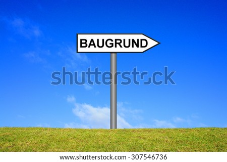 Street Sign showing Plot in german language in front of blue sky on green grass - stock photo