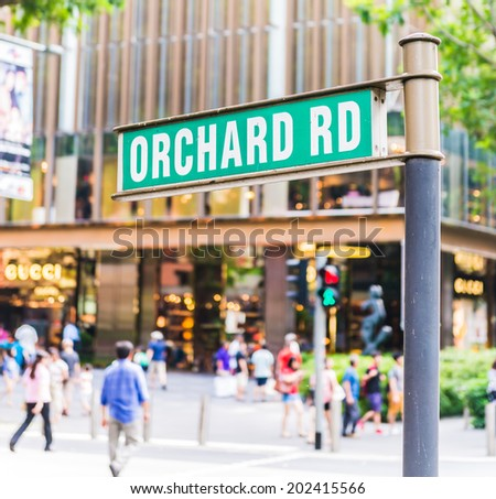 "street sign that read "" Orchard Road"" - stock photo"
