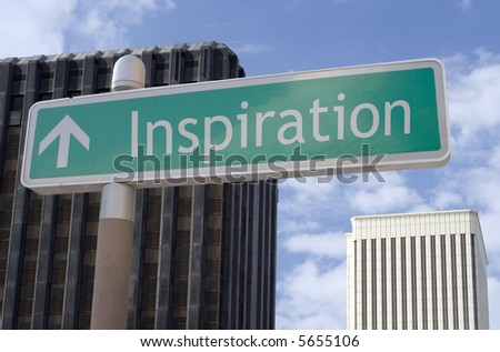 "Street sign with an arrow and the word ""inspiration"" located in a business district. - stock photo"