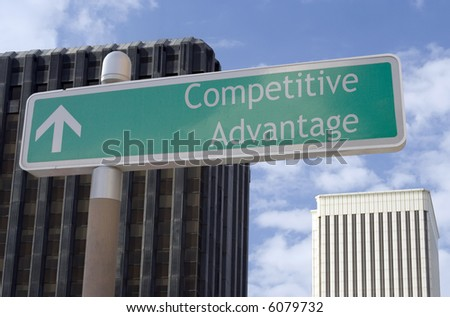 "Street sign with an arrow and the words ""competitive advantage"" located in a business district. - stock photo"