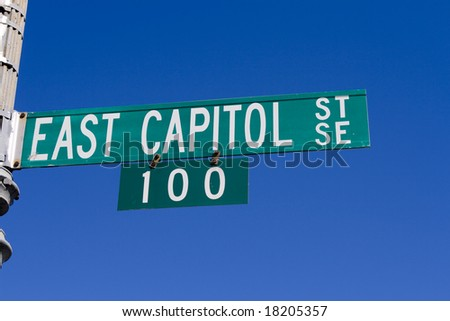 Street sign with text: East capitol street at Capitol hill in Washington DC - stock photo