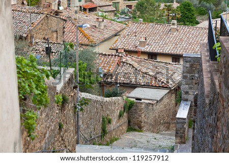 Street-stairs in small italian town. House roofs view - stock photo