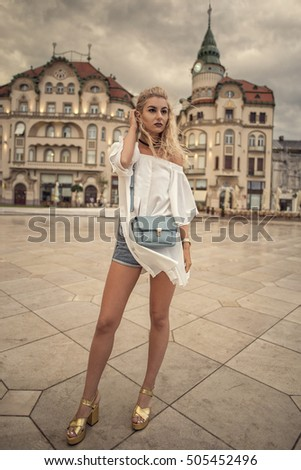 Street Style woman posing in European City