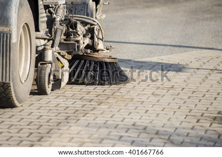 Street sweeper machine cleaning the street - stock photo