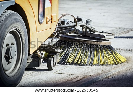 street sweeper machine cleaning the streets in vienna - stock photo