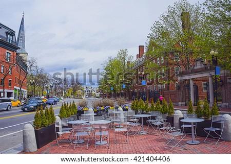 Street view in Harvard University Area in Cambridge, Massachusetts, USA. Tourists in the street. - stock photo