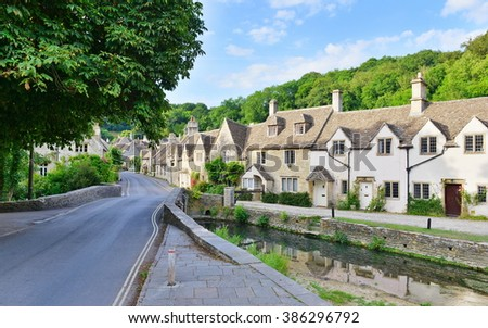 Street View of Old Riverside Cottages in a Picturesque Village - Namely the Landmark Castle Combe in Wiltshire England - stock photo
