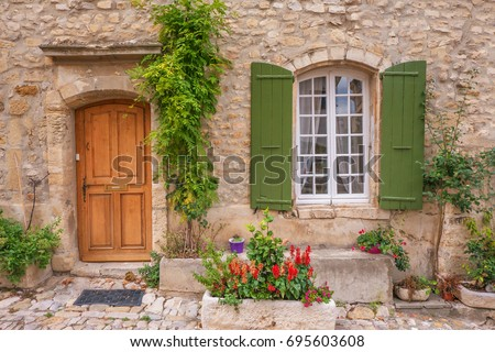 Street view quaint french provincial house stock photo for Cobblestone shutters