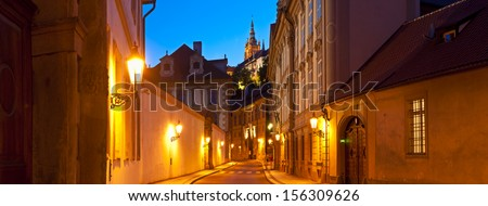 Street view of St Vitus Cathedral (1714) illuminated at night in the magical city of Prague. - stock photo
