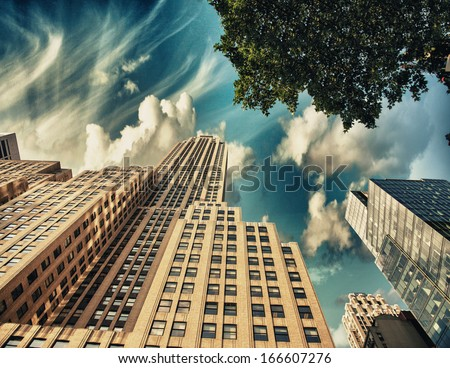 Street view of tall skyscrapers in Manhattan - New York. - stock photo
