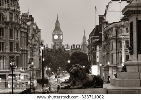 Street view of Trafalgar Square at night in London in BW - stock photo