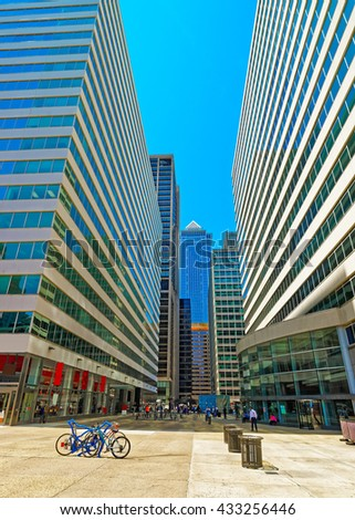 Street view on Penn Center and skyline of skyscrapers in Philadelphia, Pennsylvania, the USA. It is a central business district in Philadelphia. Tourists in the street. - stock photo