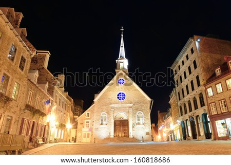 Street view with Notre-Dame des Victoires at night in Quebec City - stock photo