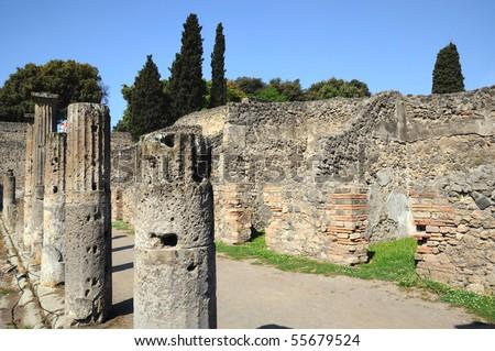 Street with columns in pompeii - stock photo
