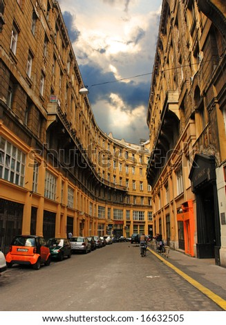 Street with curved house in Budapest - stock photo