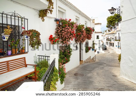 Street with flowers in the Mijas town, Spain.  - stock photo