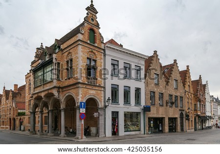 Street with historic houses in Bruges city center, Belgium - stock photo