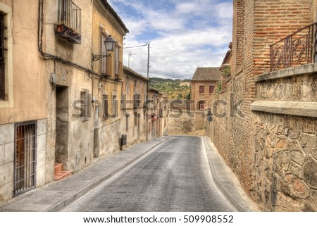 Street with historical houses in Toledo, Spain