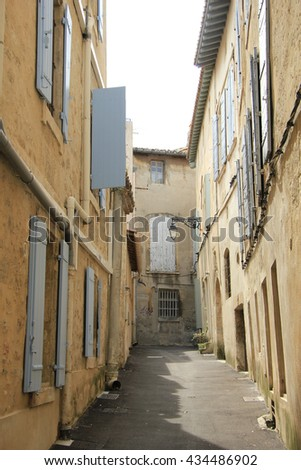 Street with old houses in Arles, Provence - stock photo