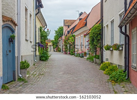 Street with old houses in Visby, a medieval town on the island of Gotland, Sweden. - stock photo