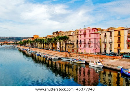 Street with palm trees along the coast in bosa, sardegna - stock photo