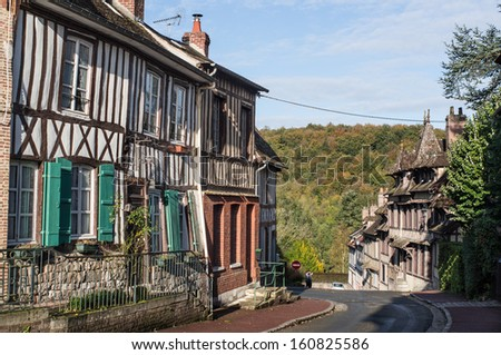 Street with timber frame buildings in timber frame building in Lyons la foret, eure, upper normandy, France - stock photo