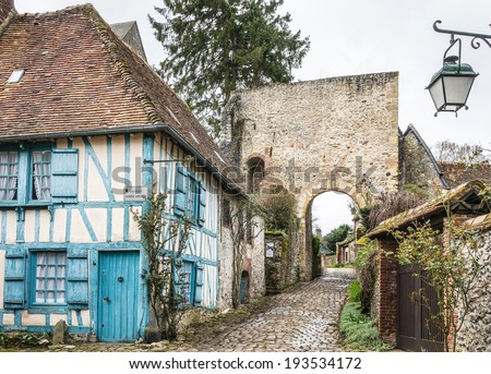Street with timber frame houses in Gerberoy, Oise, France - stock photo
