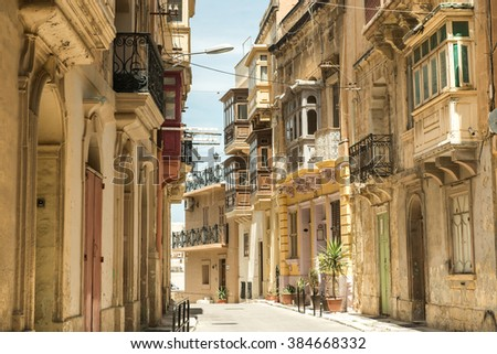 street with traditional balconies in historical center of Valletta in Malta