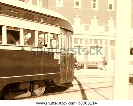Streetcar, circa 1955, in sepia.  This was a Toronto Transit Commission / TTC unit until it was brought west for use at Fort Edmonton historic park, Alberta Canada.  San Francisco also uses this model