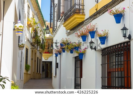 Streets decorated with flowers and barred windows typical of the city of Cordoba, Spain - stock photo