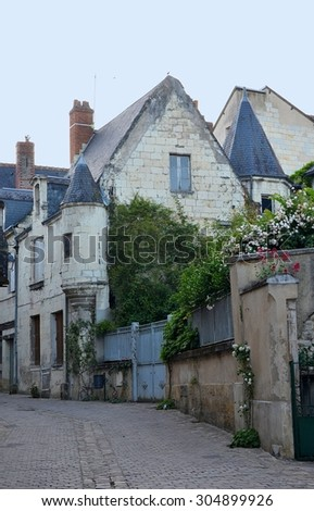 Streets of Chinon city with old stone buildings, France - stock photo