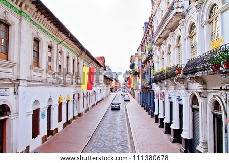 Streets of Cuenca Ecuador during the festivities with city flags