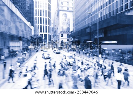 Streets of Hong Kong City. People cross the road at a pedestrian crossing.