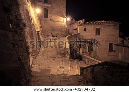 Streets of old european town at dusk - stock photo