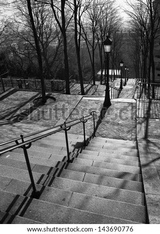 Streets of Paris in black and white. Stairs in Paris