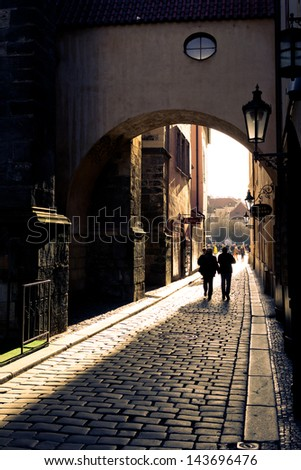 Streets of Prague. Couple walking on streets of Prague - stock photo