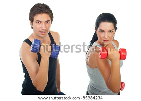 Strength couple lifting barbell in front of camera isolated on white background - stock photo