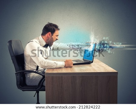 Stress and frustration of a businessman due to computer error - stock photo