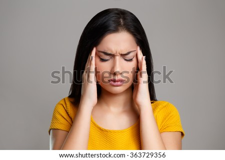Stress and Headache. Young Woman having Migraine Pain - stock photo