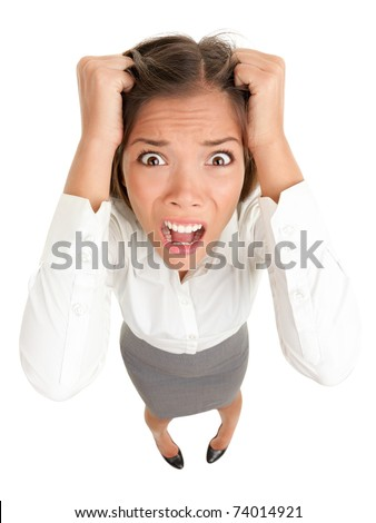 Stress. Business woman frustrated and stressed pulling her hair. Funny image of young Caucasian Asian businesswoman - stock photo