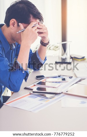 Stress businessman headache while work with order problem from many phone call