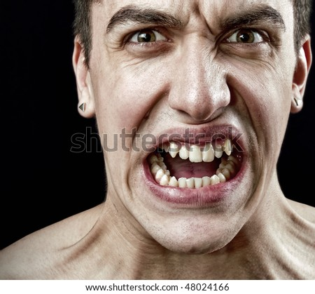 Stress concept - grimace of angry furious stressed man - stock photo