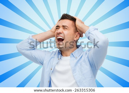 stress, headache, health care and people concept - unhappy man with closed eyes touching his head blue burst rays background - stock photo