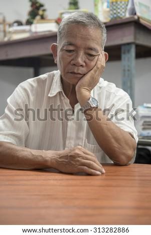 Stress - Old man stressed - stock photo