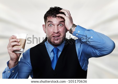 stress out business man pulling at his hair and squashing a paper coffee cup - stock photo